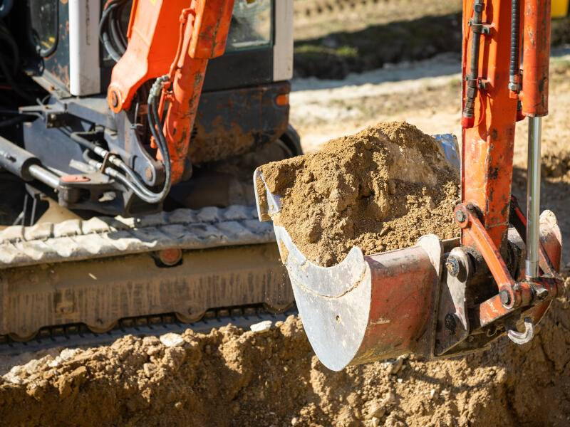 Close-up of excavator working on construction site